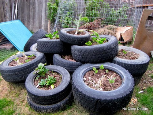 How to a build a cheap raised garden bed for How to use old tires in a garden